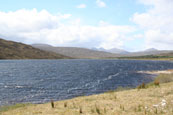 Loch a Chroisg near Achnasheen, Wester Ross, Scotland, with the Torridon Mountain Range in the background