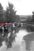 Canal boats moored on the Brecon Canal near Brecon, Wales