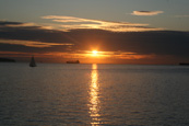 The sun setting on English Bay, Vancouver, British Columbia, Canada